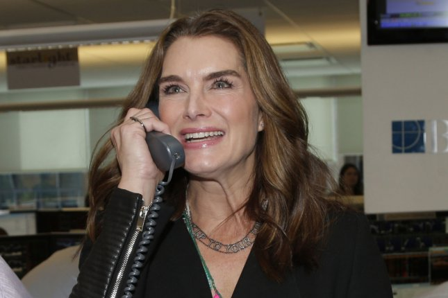 Brooke Shields fields calls at the BTIG Commissions for Charity event on April 28, 2015. The actress says Tom Cruise apologized for their feud in 2006. File Photo by John Angelillo/UPI