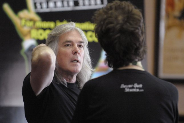Musician Cliff Williams (L) of the band AC/DC talks with musician Glenn Hughes of the band Deep Purple at Rock 'n' Roll Fantasy Camp in Los Angeles on February 17, 2008. Williams has announced his retirement following the conclusion of AC/DC's latest tour. FIle Photo by Phil McCarten/UPI