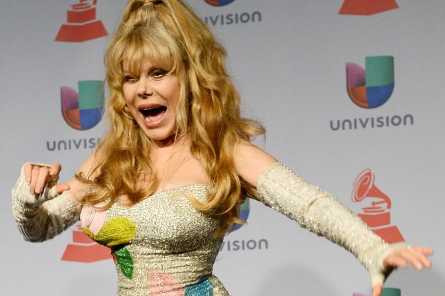Charo appears backstage at the Latin Grammy Awards at the Mandalay Bay Events Center in Las Vegas on November 21, 2013. The entertainer was eliminated from DWTS Monday night. File Photo by Jim Ruymen/UPI