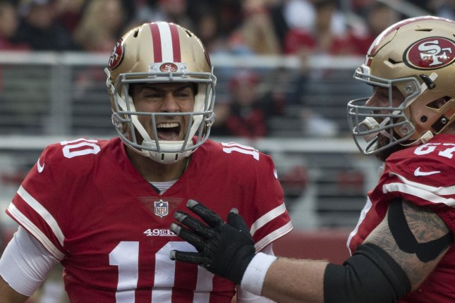 San Francisco 49ers QB Jimmy Garoppolo (10) celebrates with center Daniel Kilgore after scoring a one yard TD against the Jacksonville Jaguars in the first quarter at Levi's Stadium in Santa Clara, California, California on December 24, 2017. File photo by Terry Schmitt/UPI
