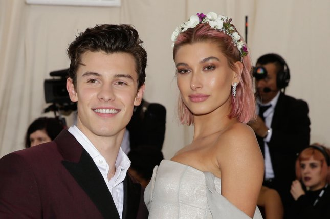 Shawn Mendes (L) and Hailey Baldwin arrive on the red carpet at the 2018 Met Gala on Monday. The event was the red carpet debut for the rumored couple. Photo by John Angelillo/UPI