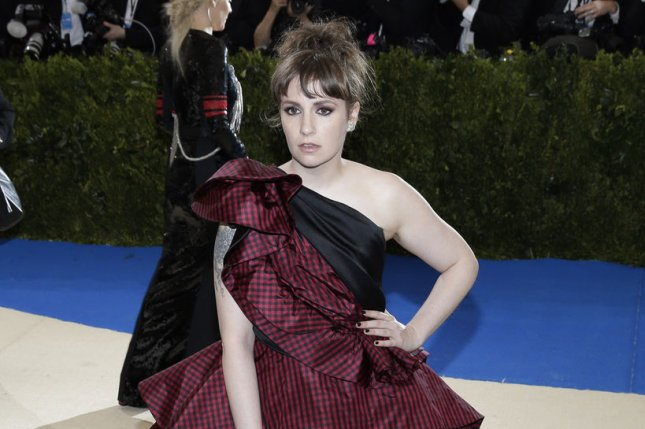 Lena Dunham went public about her Ehlers-Danlos syndrome diagnosis after paparazzi photographed her walking with a cane. File Photo by John Angelillo/UPI