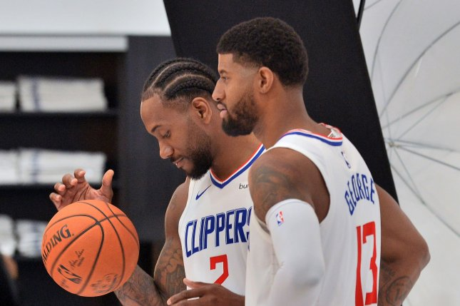 Los Angeles Clippers forward Kawhi Leonard (L) has missed the last three games due to a knee injury. Paul George (R) made his Clippers debut on Thursday against the New Orleans Pelicans. File Photo by Jim Ruymen/UPI