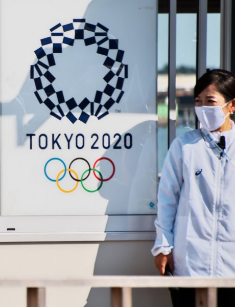 Employees of the Tokyo Organizing Committee of the Olympic and Paralympic Games are seen screening spectators and officials for COVID-19, in Tokyo, Japan, on October 21, 2020. File Photo by Keizo Mori/UPI