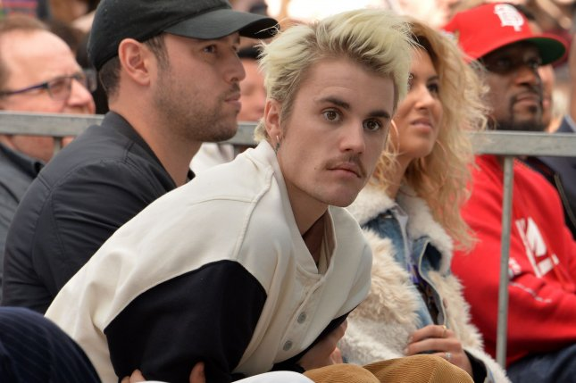 Justin Bieber will perform at the Nickelodeon Kids' Choice Awards, hosted by Kenan Thompson, in March. FilePhoto by Jim Ruymen/UPI