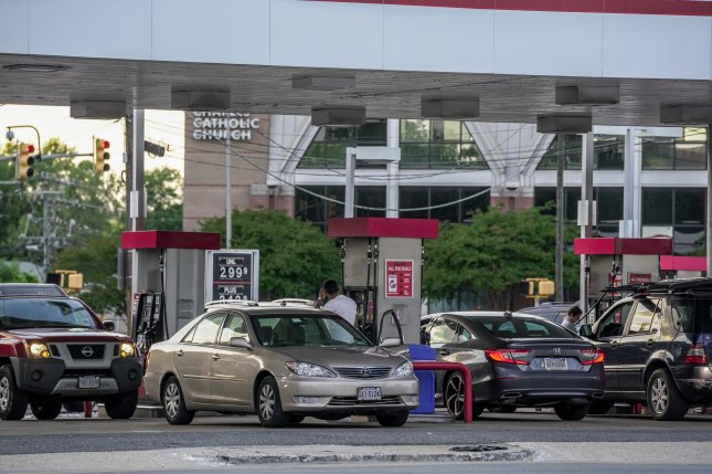 Drivers line up at an Arlington, Va., gas station to buy fuel on May 13, amid shortages due to the Colonial Pipeline attack. Photo by Jemal Countess/UPI