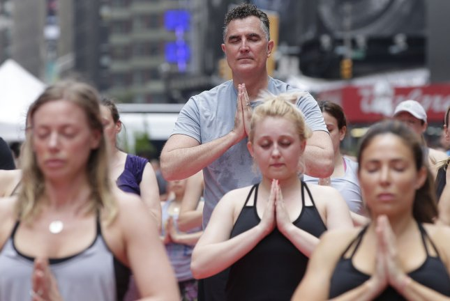 New research suggests that yoga can help people more effectively deal with work-related stress. File Photo by John Angelillo/UPI