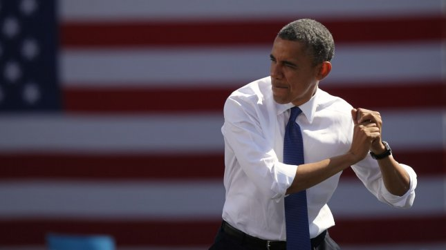 President Barack Obama swings a make-believe baseball bat as he takes the state to speak at a campaign event at G. Richard Pfitzner Stadium in Woodbridge, Virginia on September 21, 2012. UPI/Molly Riley