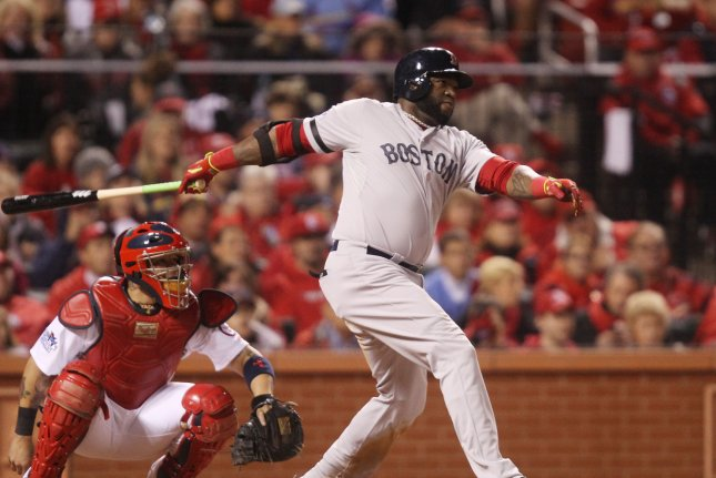 Boston Red Sox David Ortiz swings the bat, hitting a double in the fifth inning against the St. Louis Cardinals in Game 4 of the World Series at Busch Stadium in St. Louis on October 27, 2013. Boston won the game 4-2 and the series is now tied at two games each.(File/UPI/Bill Greenblatt)