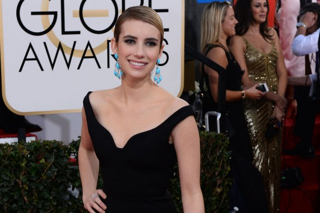 Actress Emma Roberts arrives for the 71st annual Golden Globe Awards at the Beverly Hilton Hotel in Beverly Hills, California on January 12, 2014. UPI/Jim Ruymen