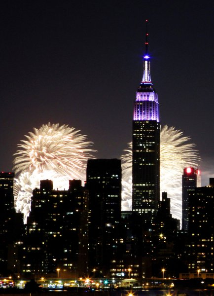 Fourth of July Fireworks erupt behind the Empire State Building (right-center) in New York City on July 4, 2014. (The world-famous skyscraper was dedicated May 1, 1931.) File Photo by John Angelillo/UPI