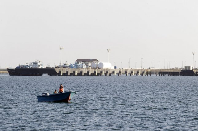 Iran says it will send out invitations to energy companies to explore a resumption of work by next month. Pictured, an Iranian speed boat passes by the oil dock on the shore of the Sea of Oman in the Iranian Free trade zone of Chabahar, Iran on January 17, 2012. File photo by Maryam Rahmanian/UPI
