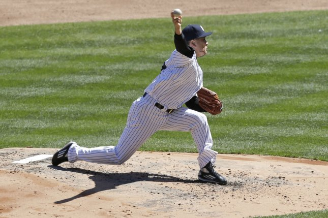 New York Yankees starting pitcher Masahiro Tanaka throws a pitch in the 3rd inning. File photo by John Angelillo/UPI