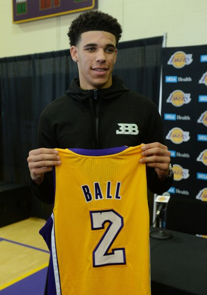 Lonzo Ball holds up his jersey during a news conference after the Los Angeles Lakers selected him with the No. 2 overall draft pick. Photo by Jim Ruymen/UPI