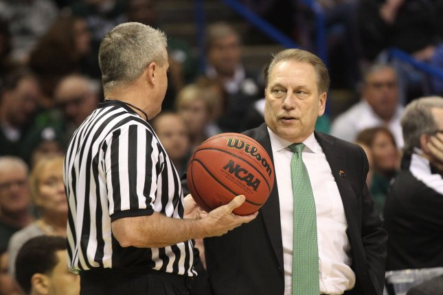 Michigan State's head basketball coach Tom Izzo talks with an official. File photo by Bill Greenblatt/UPI