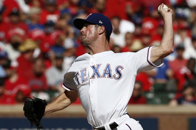 Former Texas Rangers and current Chicago Cubs starting pitcher Cole Hamels delivers against the Toronto Blue Jays in the second inning on October 6, 2016 at Globe Life Park in Arlington, Texas. File photo by Mike Stone/UPI