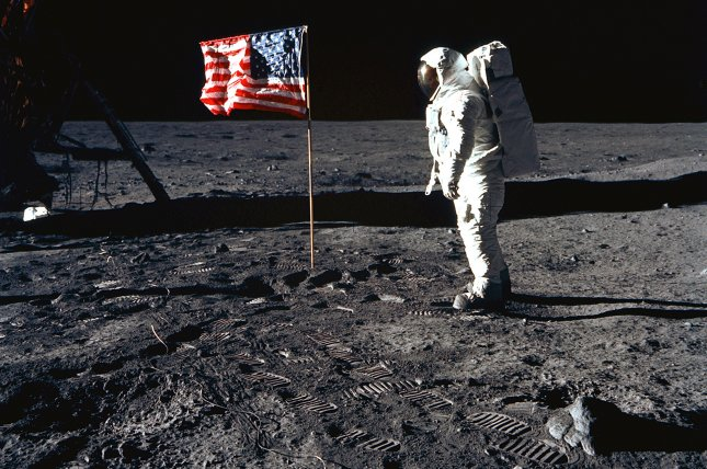 Astronaut Buzz Aldrin poses for a photograph beside the deployed United States flag during Apollo 11 mission. The flag is no longer standing. File Photo courtesy of NASA