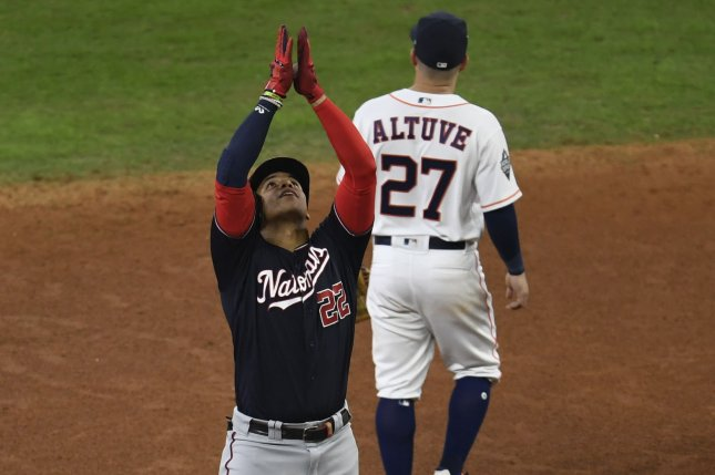 Washington Nationals outfielder Juan Soto (22) celebrates his two-run double against the Houston Astros in the fifth inning of Game 1 of the World Series on Tuesday at Minute Maid Park in Houston. Photo by Trask Smith/UPI