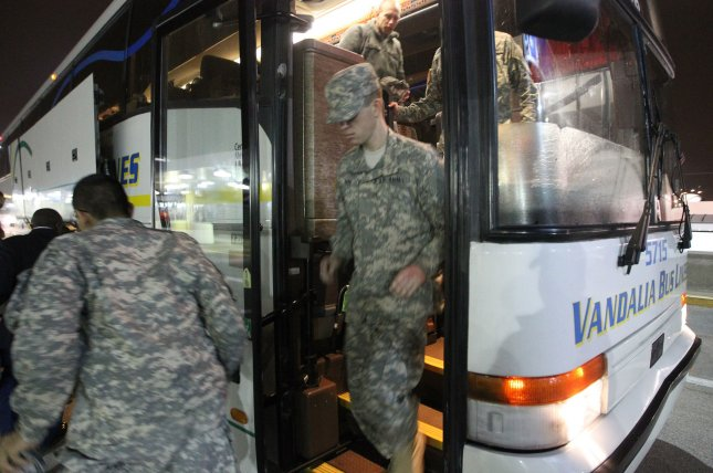 A soldier leaves his bus upon arriving for holiday block leave at Lambert-St. Louis International Airport on December 20, 2014. The Department of Defense halted all domestic travel for U.S. service members and their families. File Photo by Bill Greenblatt/UPI