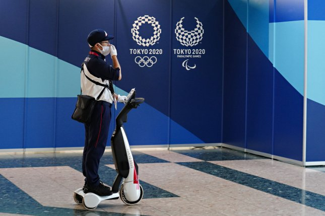 A security guard rides an electric scooter as he patrols the Main Press Center before the start of the Tokyo 2020 Summer Olympics, in Tokyo, Japan on Monday, July 19, 2021. Photo by Richard Ellis/UPI