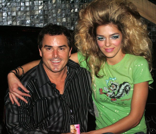 Chris Knight (of the Brady Bunch) and Adrienne Curry who appear on VH1's TV series, Surreal Life, visit Pamela Anderson's unveiling of her new clothing line featuring lingerie, apparel and accessories at the Palms Casino Resort in Las Vegas for the MAGIC clothing convention, February 16, 2005..(UPI Photo/ Roger Williams)