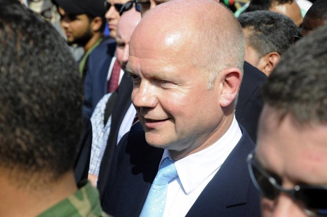 British Foreign Secretary William Hague (C) tours Revolution Square in the Libyan rebel stronghold of Benghazi on June 4, 2011 during an official visit for talks with the Libyan opposition's leadership. UPI\Tarek Alhuony.