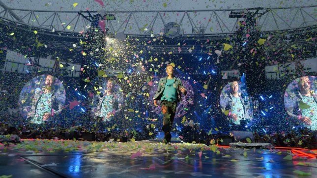 Chris Martin of Coldplay performs on stage at The Emirates Stadium in London on June 1, 2012. UPI/Paul Treadway