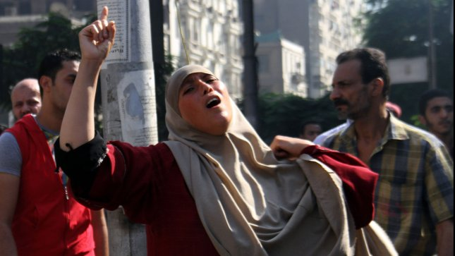 Egyptian woman cry after killing her relative after clashes broke out during a demonstration in support of Egypt's ousted president Mohamed Morsi, in Cairo Egypt on August 16, 2013. UPI/Ahmed Jomaa