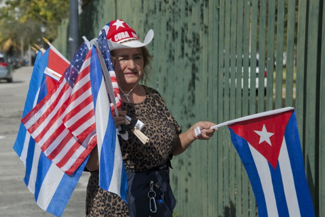 Margarita Sabadago has her flags ready to sell during the Anti-Castro gathering in Jose Marti park in Little Havana, Miami, Florida, Dec. 20, 2014. UPI/Gary I Rothstein