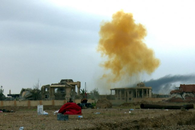 Smoke rises during fighting between Iraqi army and Islamic State militants, in Tikrit. On Sunday, Col. Steve Warren announced an IS rocket expert had been killed by a U.S. drone attack in northern Iraq. Photo by Alaa mohamed/UPI