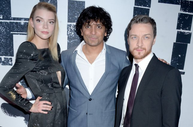 Anya Taylor-Joy, M. Night Shyamalan and James McAvoy arrive on the red carpet at the New York premiere of 'Split' on January 18, 2017. Photo by Dennis Van Tine/UPI