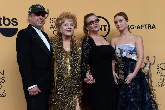 Todd Fisher (L) with mom Debbie Reynolds, sister Carrie Fisher and niece Billie Lourd (L-R) at the Screen Actors Guild Awards on January 25, 2015. Reynolds and Fisher both died in December. File Photo by Jim Ruymen/UPI