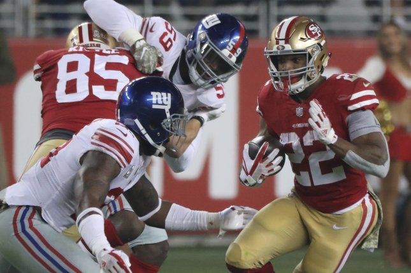 San Francisco 49ers running back Matt Breida (22) runs against the New York Giants on November 12 at Levi's Stadium in Santa Clara, California. Photo by Terry Schmitt/UPI