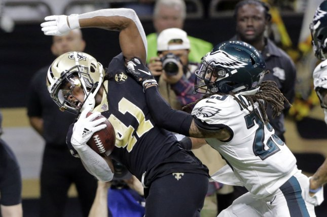 New Orleans Saints running back Alvin Kamara (41) is pushed out of bounds by Philadelphia Eagles free safety Avonte Maddox (29) during the divisional round of the NFC playoffs on Sunday at the Mercedes-Benz Superdome in New Orleans. Photo by AJ Sisco/UPI