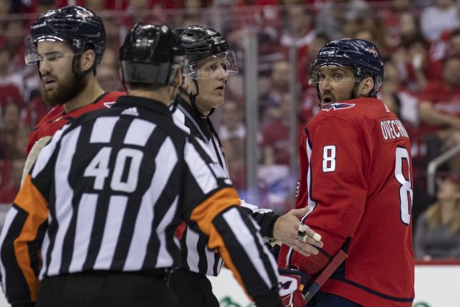 Washington Capitals left wing Alex Ovechkin (8) knocked out Carolina Hurricanes forward Andrei Svechnikov on Monday during Game 3. Both players received five minutes after the fight. Photo by Alex Edelman/UPI