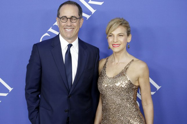 Jerry Seinfeld (L) with his wife Jessica Seinfeld. The star's Comedians in Cars Getting Coffee will return in July. File Photo by John Angelillo/UPI