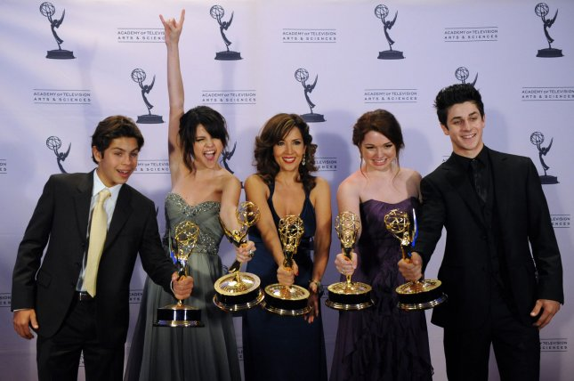 (L-R) Wizards of Waverly Place cast members Jake T. Austin, Selena Gomez, Maria Canals Barrera, Jennifer Stone and David Henrie appear together at the Creative Arts Emmy Awards in Los Angeles in 2009. Henrie welcomed his second child this weekend. File Photo by Jim Ruymen/UPI