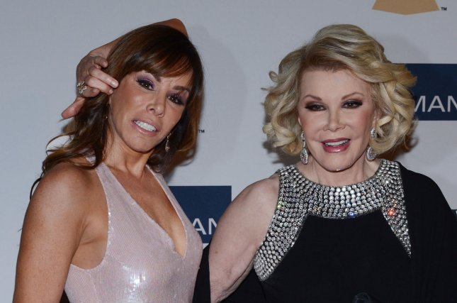 TV Personalities Joan Rivers (R) and Melissa Rivers arrive at the Clive Davis pre-Grammy party and salute to Antonio 'L.A.' Reid at the Beverly Hilton Hotel in Beverly Hills, Calif., on Feb. 9, 2013 Melissa Rivers has now taken her mom's place as a host on 'Fashion Police'. File Photo by UPI/Jim Ruymen