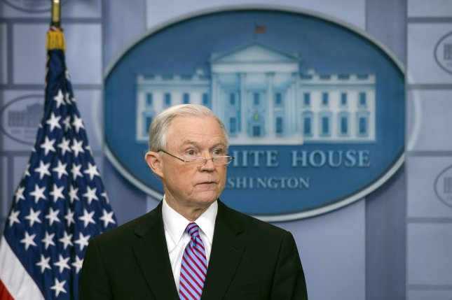 Attorney General Jeff Sessions speaks on sanctuary cities and illegal immigration at the White House in Washington, D.C., on March 27. Justice officials said Sessions didn't list his meetings with the Russian ambassador on his security clearance form, but a spokesman said an FBI official told him he didn't have to include meetings that took place in his capacity as senator. File Photo by Kevin Dietsch/UPI