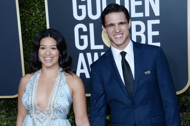 Gina Rodriguez (L), pictured with Joe LoCicero, said she was instantly attracted to the actor on the Jane the Virgin set. File Photo by Jim Ruymen/UPI
