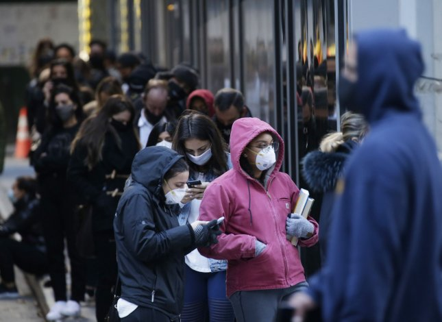 People wait on line to be tested for coronavirus in New York City on Monday. Photo by John Angelillo/UPI