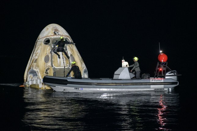 Support teams work around the SpaceX Crew Dragon Resilience spacecraft shortly after it landed with NASA astronauts Mike Hopkins, Shannon Walker, and Victor Glover, and Japan Aerospace Exploration Agency astronaut Soichi Noguchi aboard in the Gulf of Mexico off the coast of Panama City, Fla., on Sunday. Photo by Bill Ingalls/NASA