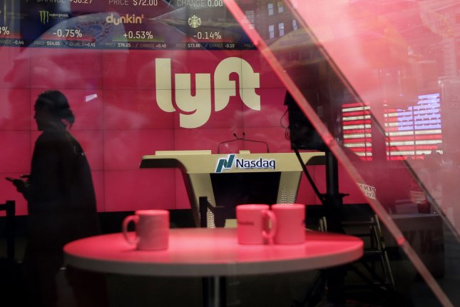 The Lyft logo is displayed at the NASDAQ marketplace in New York City on March 29, 2019. Lyft said Thursday it will start accepting passengers again in a limited number of cities. File Photo by John Angelillo/UPI