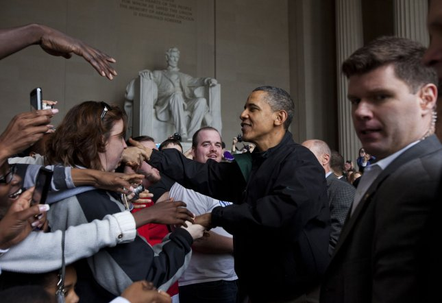 U.S. President Barack Obama shakes the hands of tourists visiting the Lincoln Memorial during a surprise visit a day after budget negotiations with Congress prevented a government shutdown in Washington, DC, on 9 April, 2011. UPI/Jim Lo Scalzo