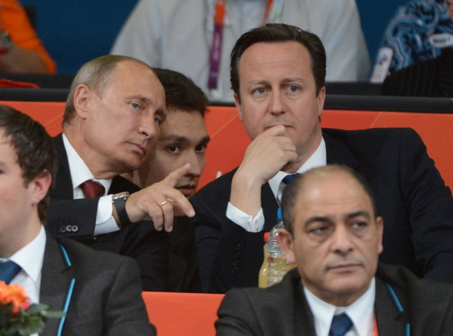Russian President Vladimir Putin talks with British PM David Cameron in the gallery at the Judo venue at the ExCel center at the London 2012 Summer Olympics on August 2, 2012 in London. The Russians took gold in Men's 100kg. UPI/Terry Schmitt