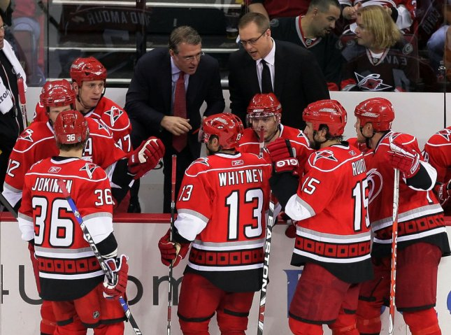 Paul Maurice, right, and associate head coach Ron Francis speak to the Carolina Hurricanes during a playoff game in 2009. Maurice was fired Monday as the Carolina coach. (UPI Photo/Jeff Basladynski)