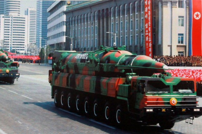 A photo of a mobile, long-range missile launcher displayed on a picture board in front of the North Korean Embassy in Beijing in 2013. U.S. defense officials believe North Korea can mount a nuclear warhead on an intercontinental ballistic missile called the KN-08. File Photo by Stephen Shaver/UPI