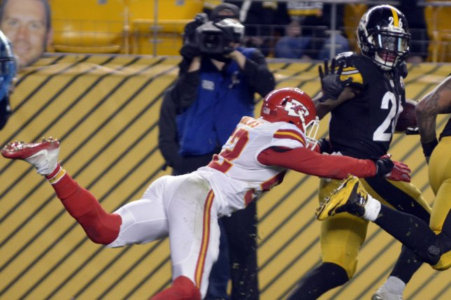 Kansas City Chiefs linebacker Dadi Nicolas (52) tackles Pittsburgh Steelers running back Le'Veon Bell (26) inside the five yard line in fourth quarter of the Steelers 43-14 win over the Kansas City Chiefs at Heinz Field in Pittsburgh on October 2, 2016. Photo by Archie Carpenter/UPI