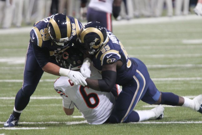 St. Louis Rams Aaron Donald (L) and William Hayes get to Chicago Bears  quaterback Jay Cutler for a sack in the second quarter at the Edward Jones  Dome in ... 02fb5fd6d
