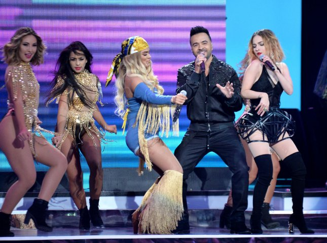 Luis Fonsi, Paty Cantu and Karol G perform onstage during the 2018 Billboard Latin Music Awards on Thursday. Photo by Jim Ruymen/UPI